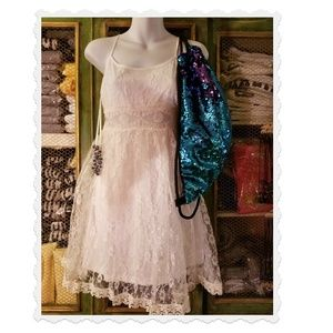 White lace short dress & blue sequin backpack 118